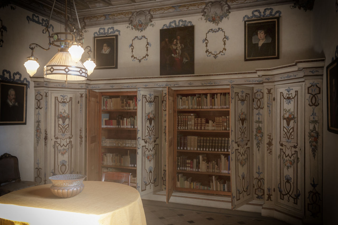 indoors, book, table, no people, bookshelf, home interior, home showcase interior, illuminated, architecture, day