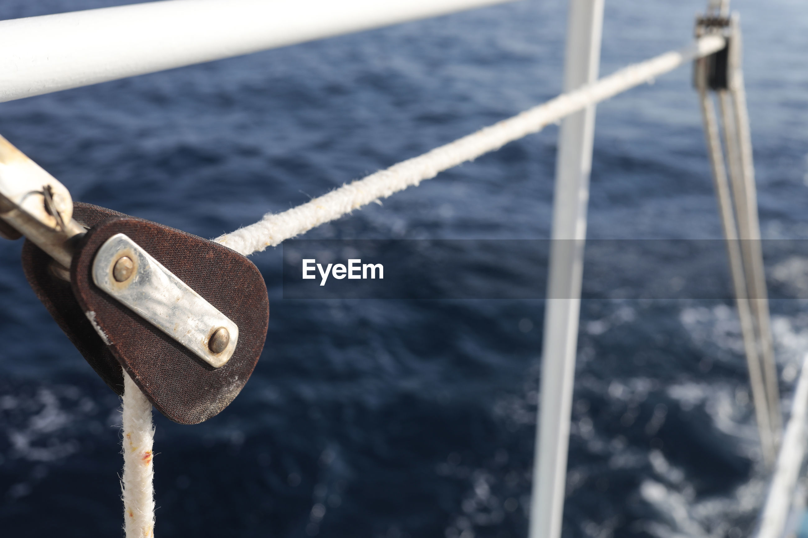 Close-up of rope in pulley on ship