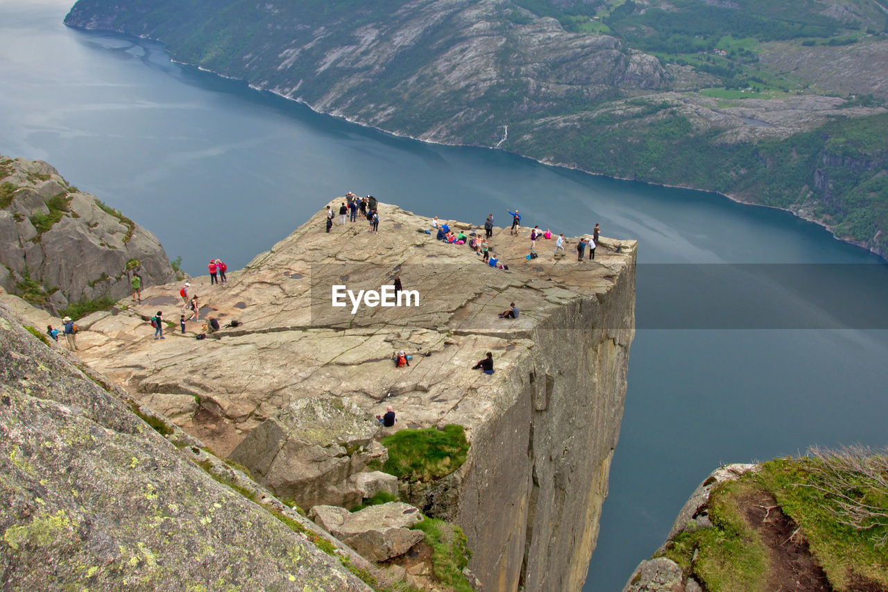 High Angle View Of People On Cliff By River