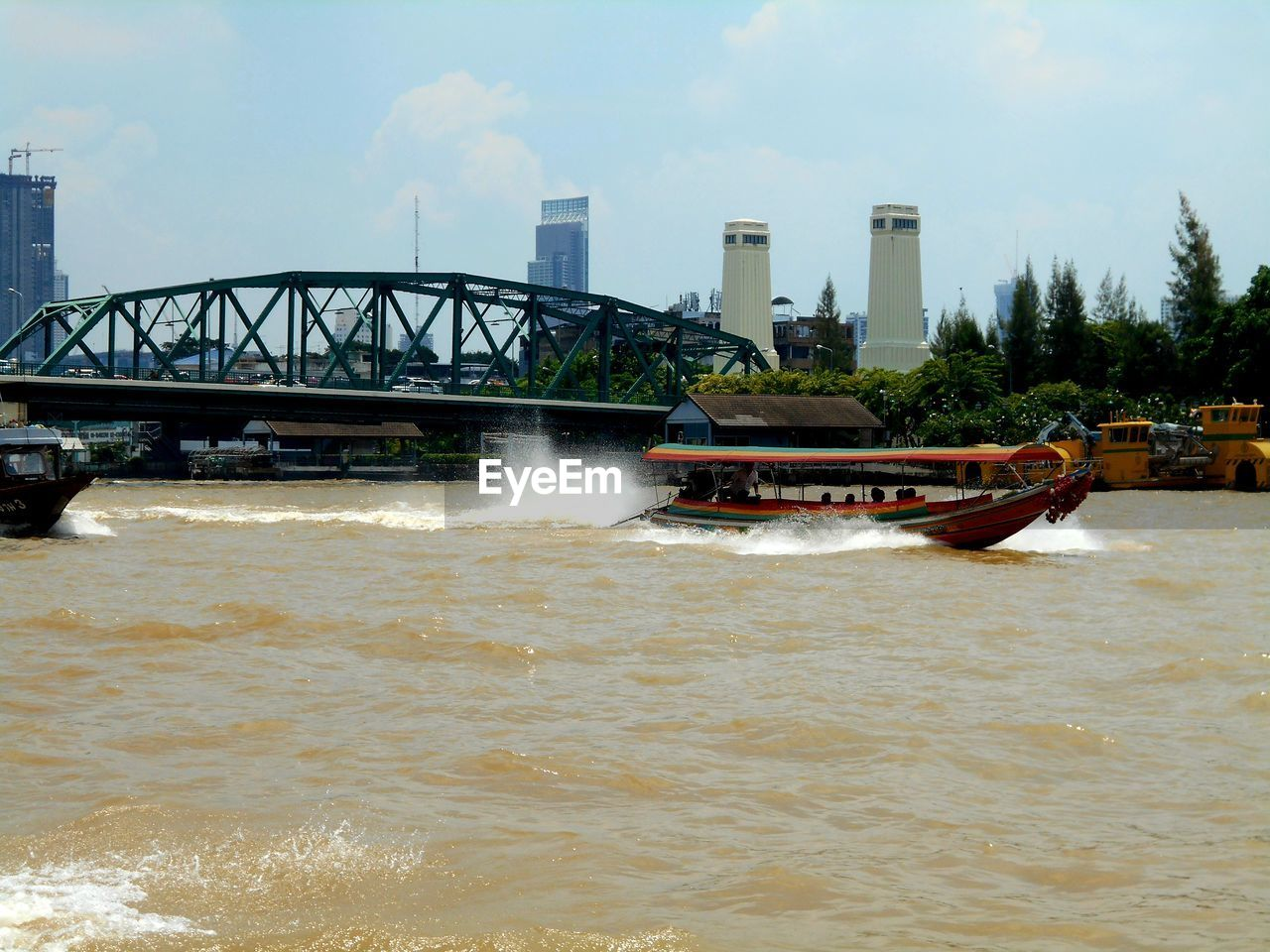 water, architecture, transportation, built structure, nautical vessel, motion, sky, waterfront, nature, bridge, mode of transportation, connection, building exterior, day, sea, no people, bridge - man made structure, outdoors, power in nature, flowing water
