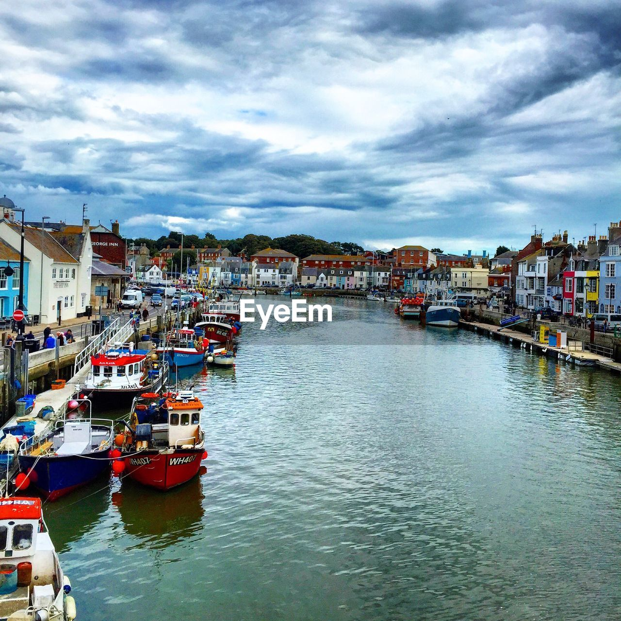 nautical vessel, building exterior, architecture, cloud - sky, built structure, water, sky, waterfront, mode of transport, boat, moored, transportation, day, outdoors, harbor, river, no people, residential building, travel destinations, nature, scenics, yacht, city