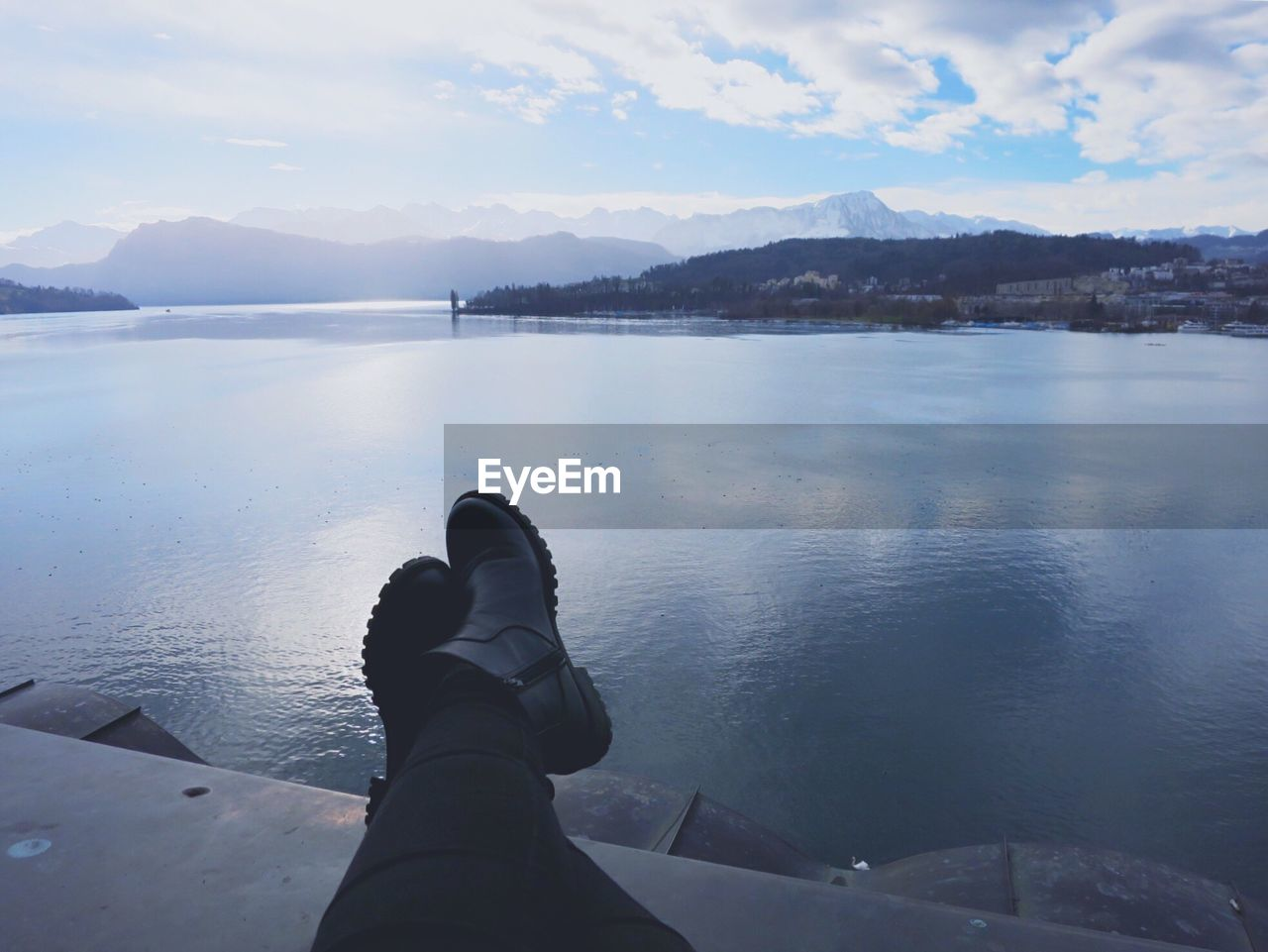 Low Section Of Person Relaxing By Lake Lucerne
