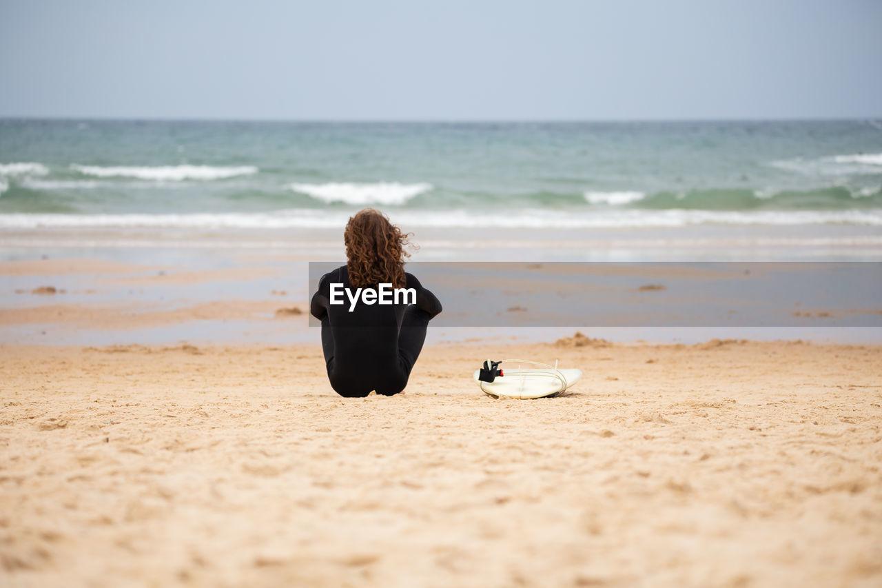 Rear view of man at beach