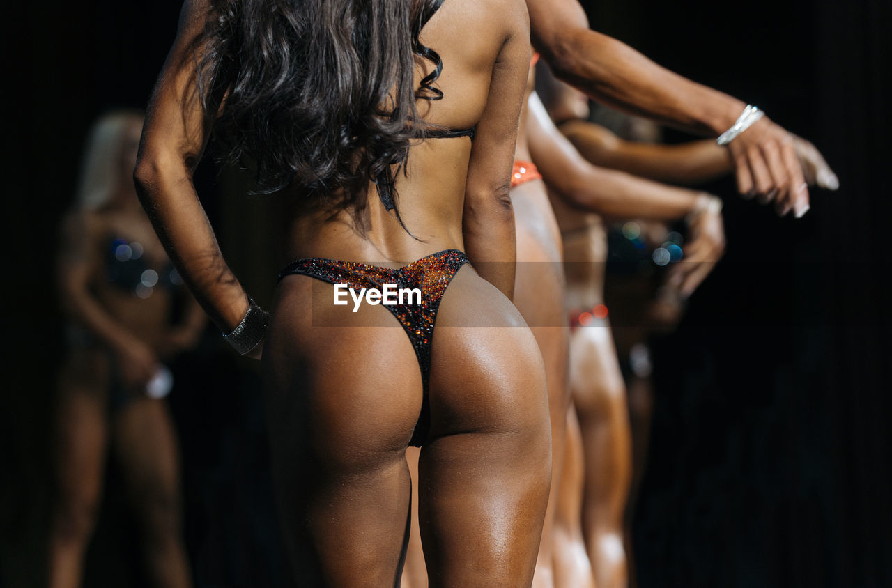 Bikini models standing on stage during competition