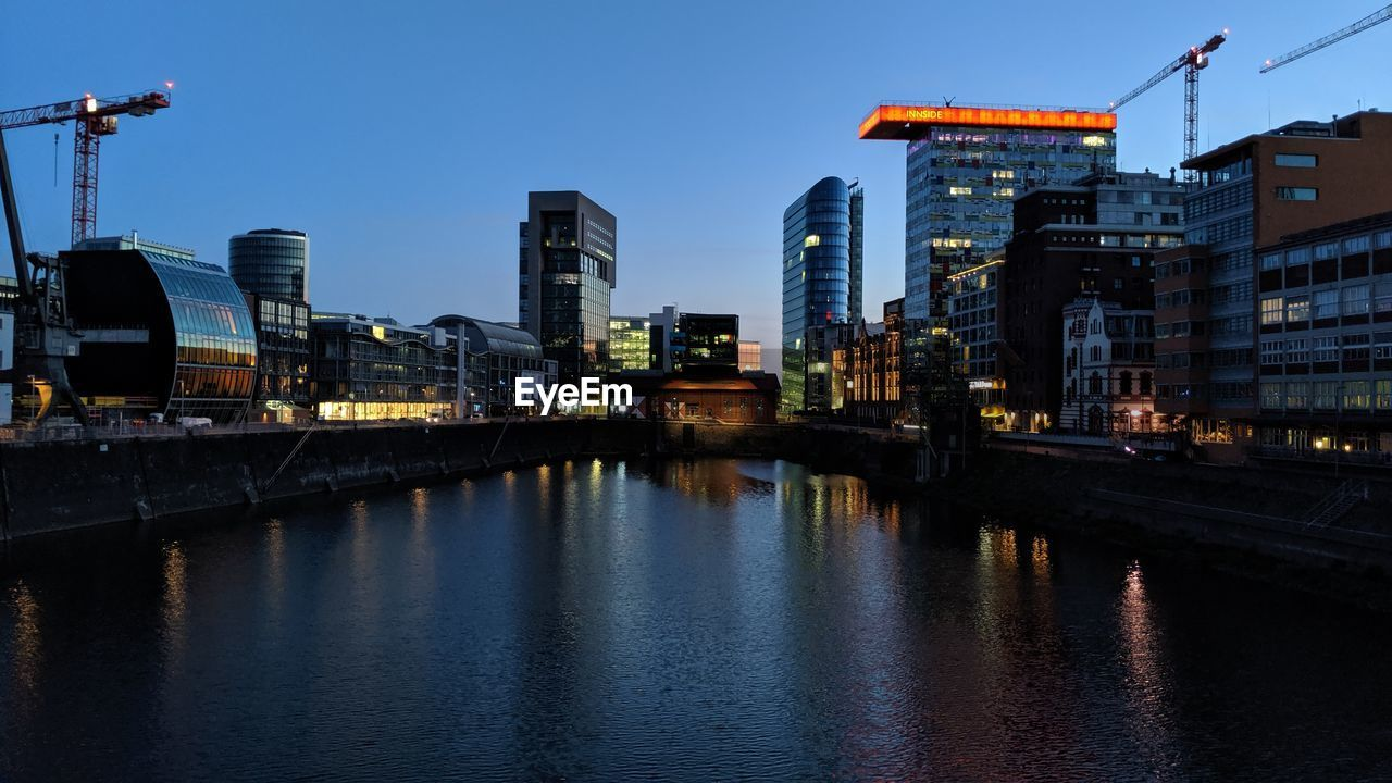 water, built structure, architecture, building exterior, sky, illuminated, waterfront, dusk, reflection, city, nature, river, transportation, no people, bridge, bridge - man made structure, connection, outdoors, clear sky, office building exterior