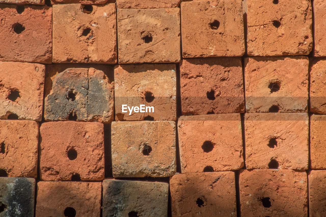 full frame, backgrounds, textured, no people, pattern, wall - building feature, built structure, rough, close-up, brick, wall, architecture, day, brown, shape, design, geometric shape, block, solid, repetition, stone wall