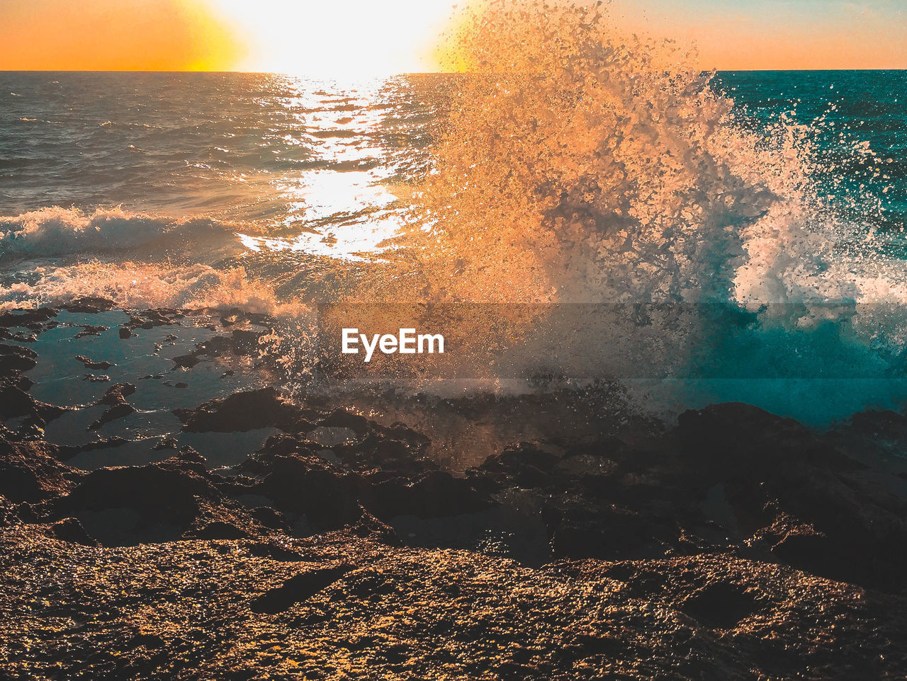 water, sea, nature, beauty in nature, wave, outdoors, no people, motion, sunset, power in nature, scenics, sunlight, day, beach, crash, sky