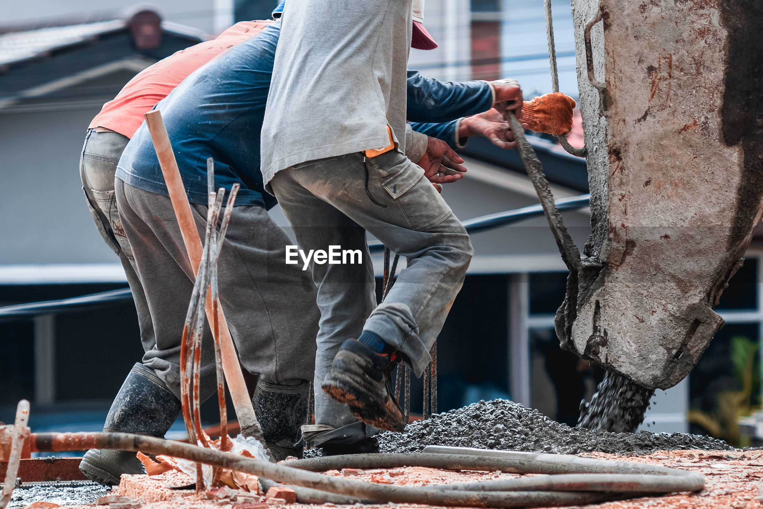 Low section of manual workers working at construction site