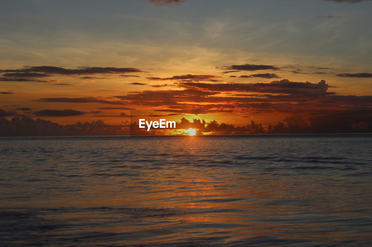 sunset, sea, sun, orange color, beauty in nature, nature, scenics, sky, water, tranquility, tranquil scene, dramatic sky, idyllic, silhouette, no people, cloud - sky, waterfront, outdoors, horizon over water, holiday