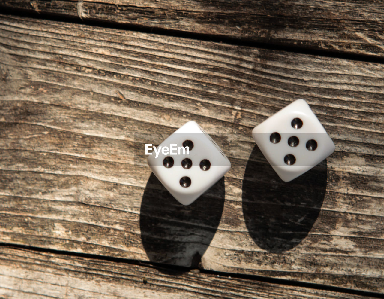 wood - material, dice, leisure games, luck, gambling, opportunity, table, arts culture and entertainment, indoors, relaxation, leisure activity, still life, two objects, no people, close-up, high angle view, plank, directly above, focus on foreground, pattern, game of chance