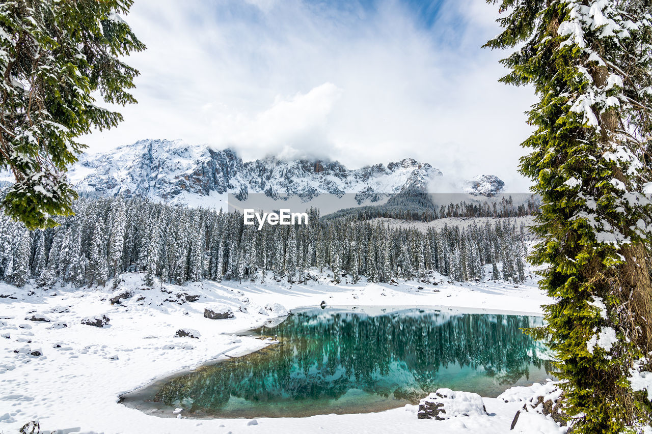 winter, cold temperature, beauty in nature, tree, tranquil scene, tranquility, scenics - nature, plant, snow, sky, water, cloud - sky, nature, non-urban scene, mountain, day, no people, environment, snowcapped mountain