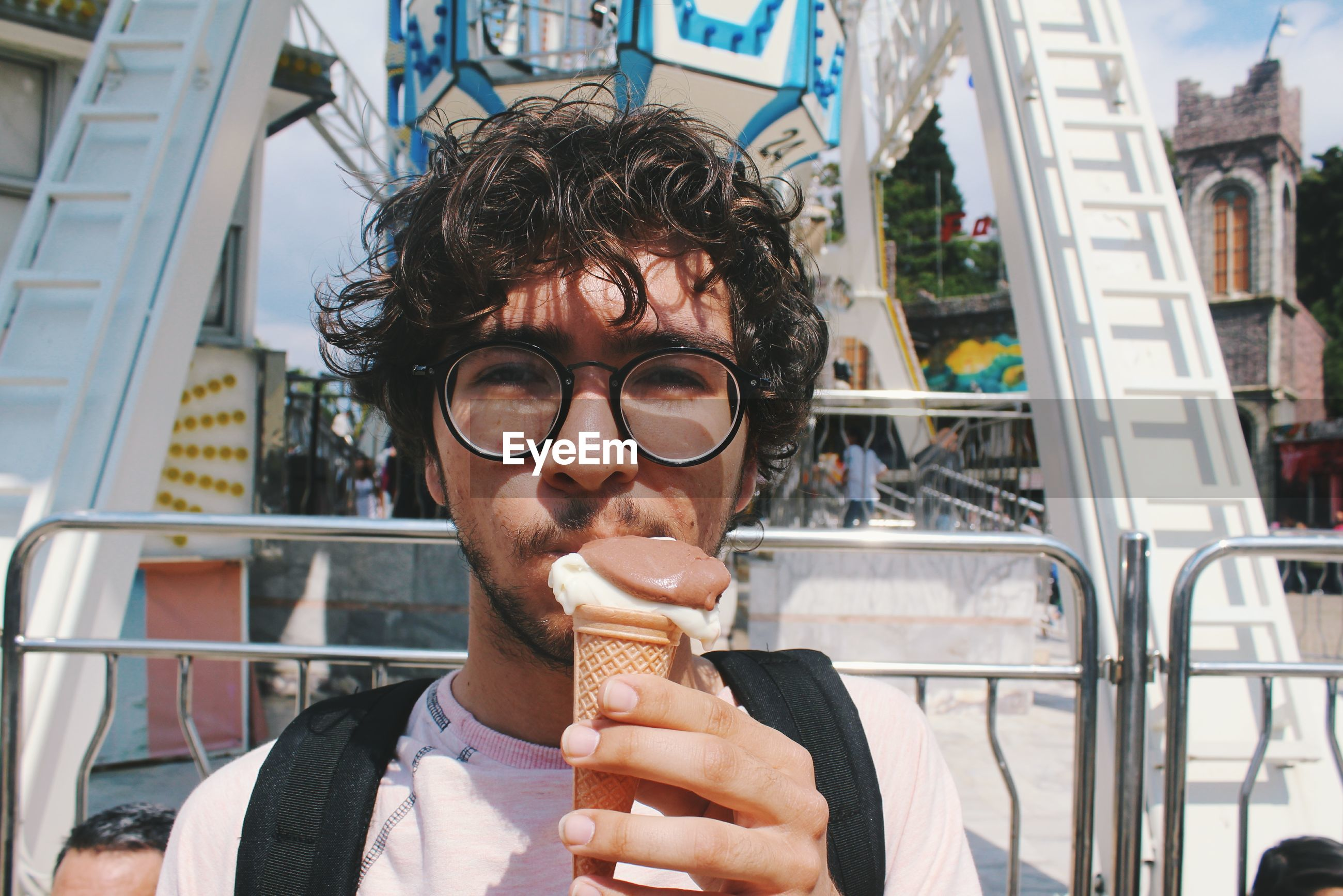 Portrait of young man eating ice cream cone
