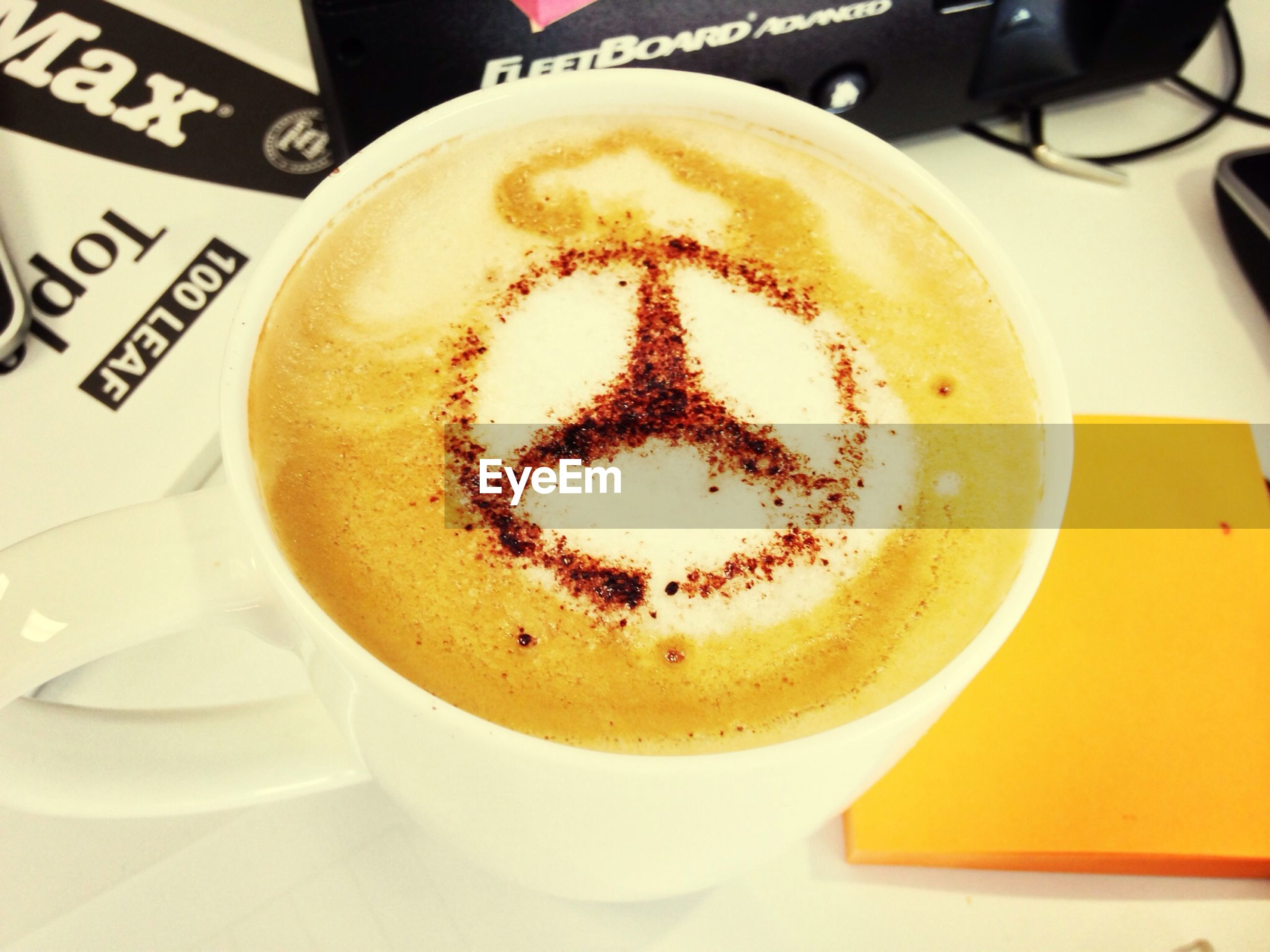 indoors, coffee cup, food and drink, drink, coffee - drink, refreshment, frothy drink, cappuccino, saucer, froth art, still life, table, close-up, coffee, freshness, cup, high angle view, heart shape, spoon, no people