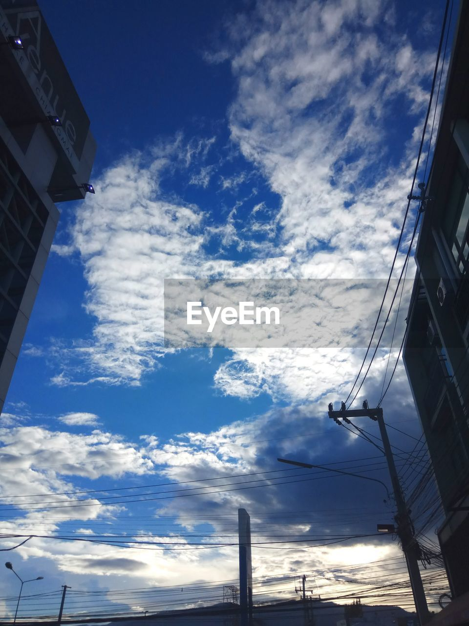sky, low angle view, cloud - sky, no people, building exterior, outdoors, built structure, architecture, day, nature, blue, beauty in nature