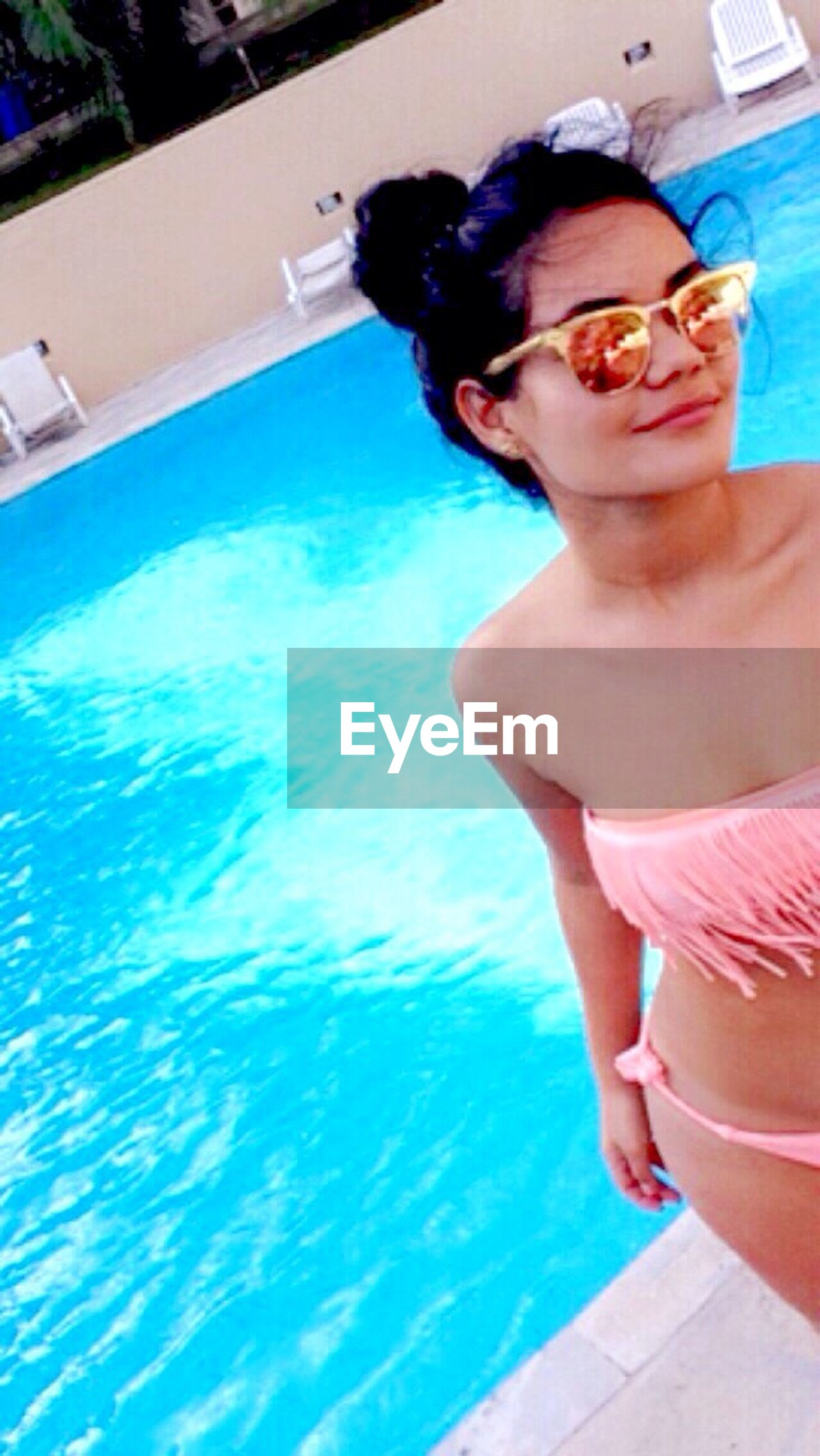 leisure activity, swimming pool, lifestyles, front view, enjoyment, summer, day, water, fun, person, young adult, blue, vacations, freshness