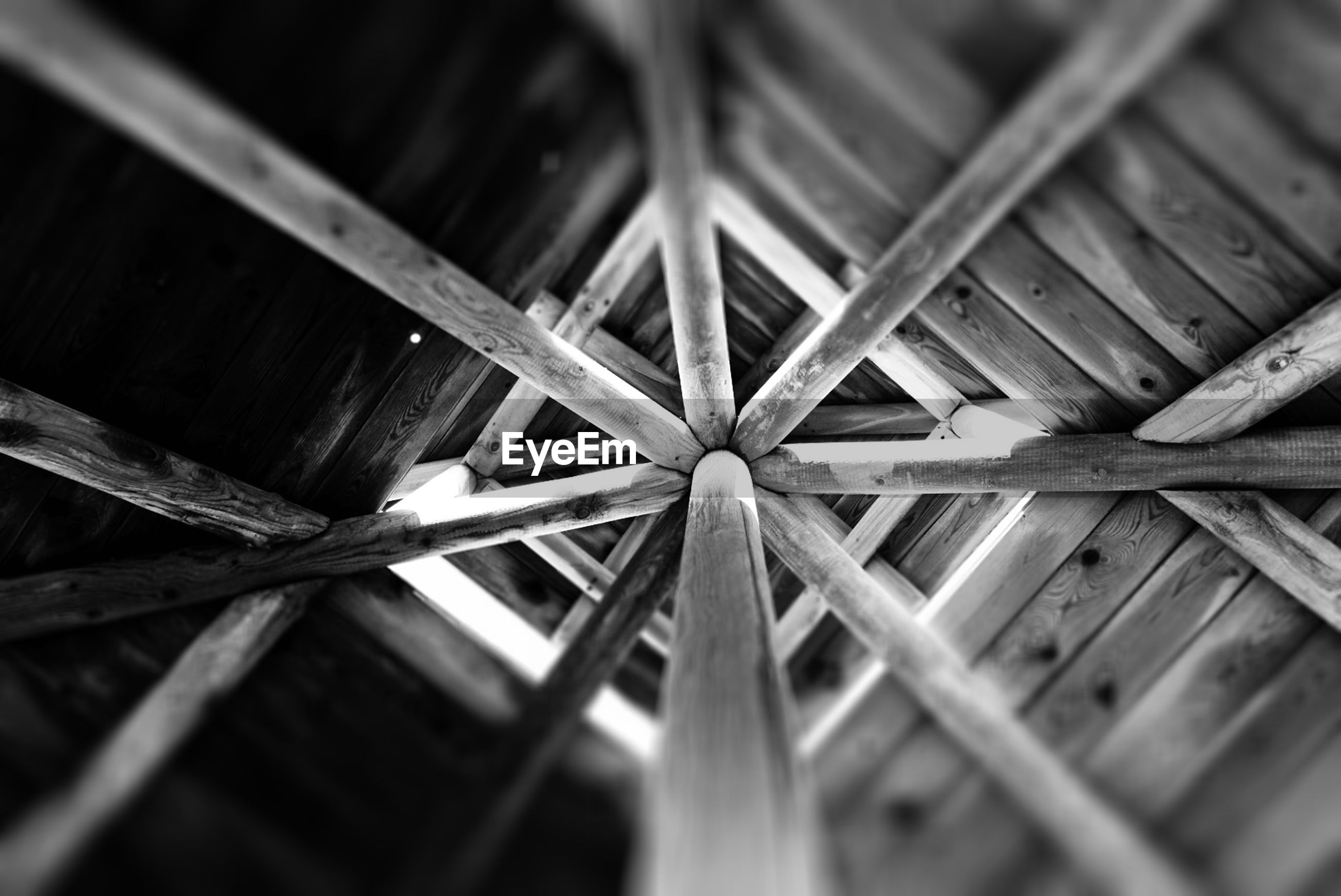 Low angle view of wooden house ceiling