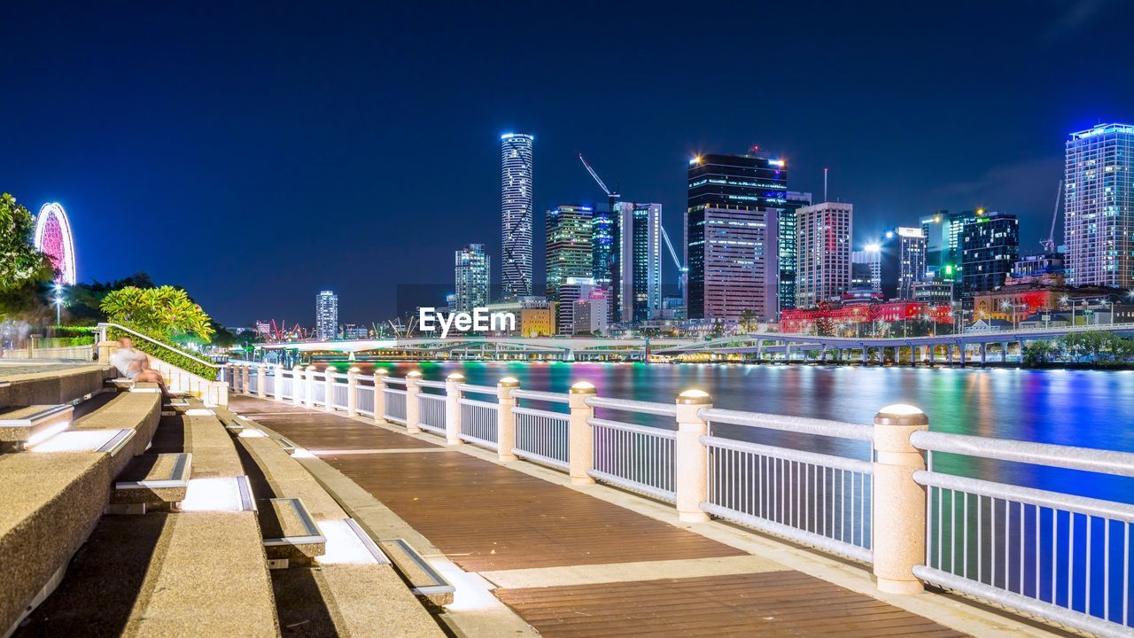architecture, built structure, building exterior, city, water, office building exterior, illuminated, building, sky, skyscraper, night, urban skyline, modern, nature, tall - high, cityscape, landscape, tower, river, no people, bridge - man made structure, financial district, outdoors, promenade