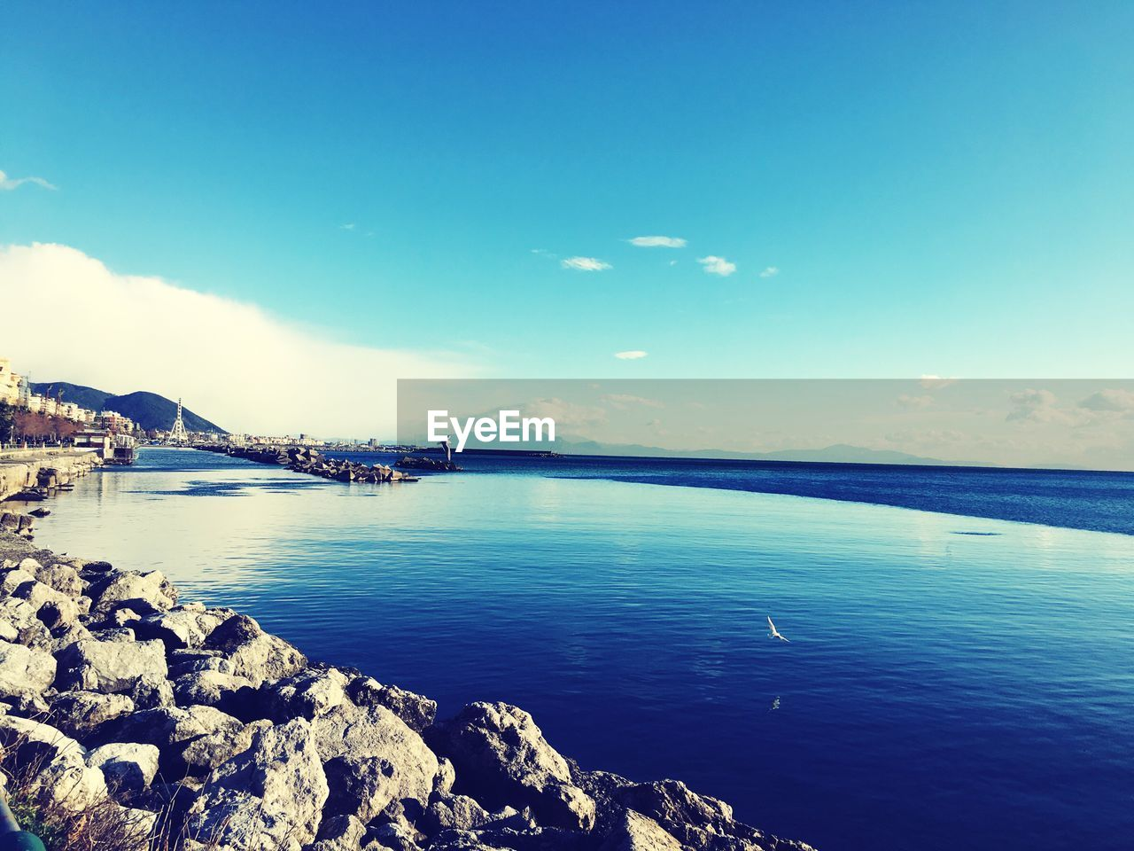 water, sky, scenics - nature, beauty in nature, sea, blue, tranquil scene, architecture, nature, built structure, tranquility, cloud - sky, no people, building exterior, waterfront, idyllic, rock, outdoors, transportation