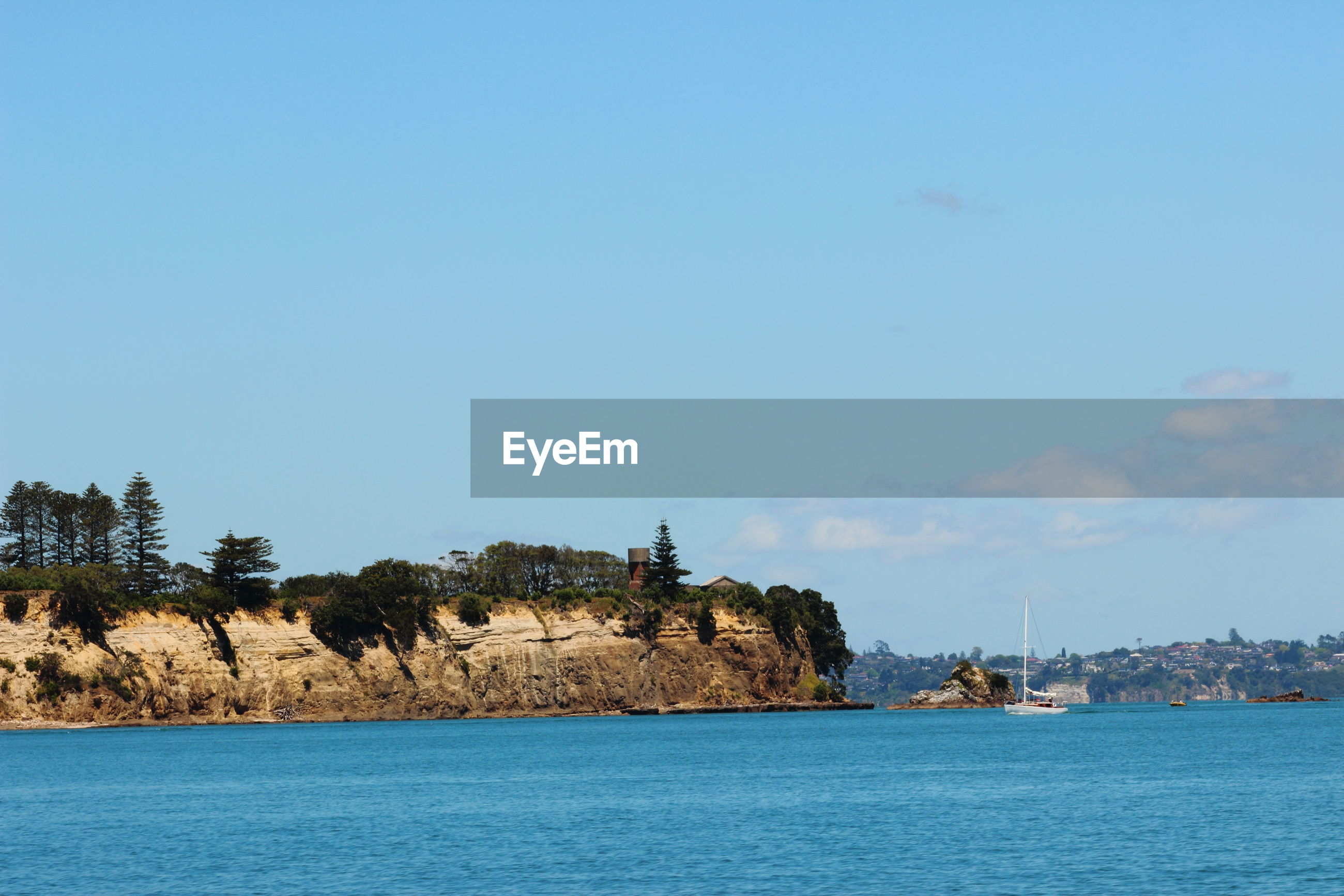Auckland Clear Sky Coastline Sailing Ship Tree Architecture Beauty In Nature Blue Sky Cliff Day Nature New Zealand No People Ocean Outdoors Sailing Scenery Sea Sky View Into Land Water Waterfront The Great Outdoors - 2018 EyeEm Awards