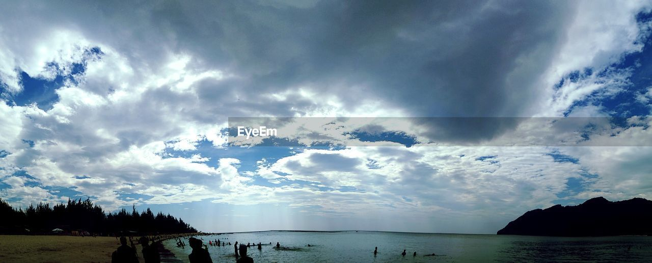 sky, cloud - sky, water, scenics, sea, nature, beauty in nature, tranquility, tranquil scene, outdoors, silhouette, horizon over water, day, beach, tree, no people