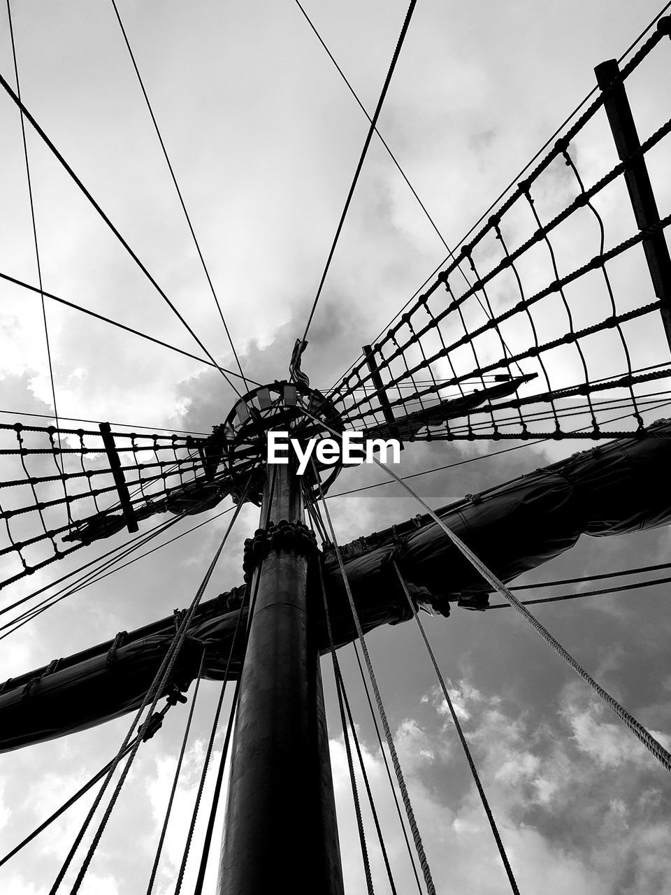 LOW ANGLE VIEW OF MAST AGAINST SKY
