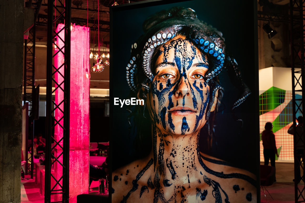 indoors, one person, portrait, real people, art and craft, looking at camera, front view, representation, headshot, creativity, arts culture and entertainment, costume, paint, focus on foreground, make-up, face paint, young adult, celebration, human face