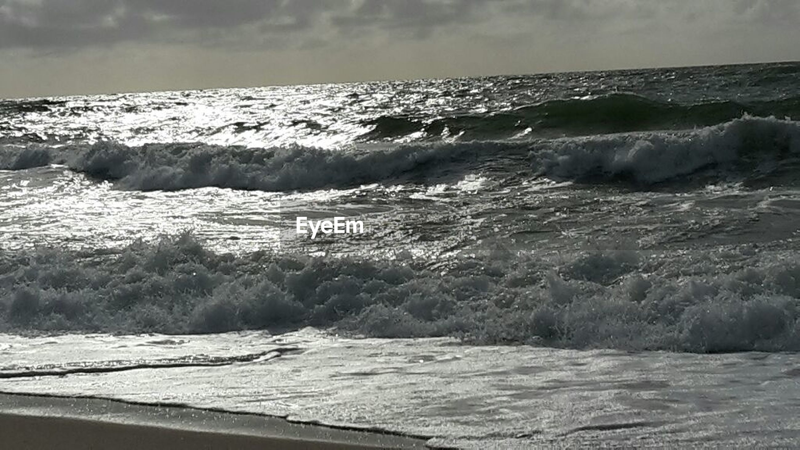 sea, wave, surf, water, beauty in nature, motion, nature, beach, horizon over water, power in nature, scenics, no people, outdoors, tide, sky, sand, day, crash, force