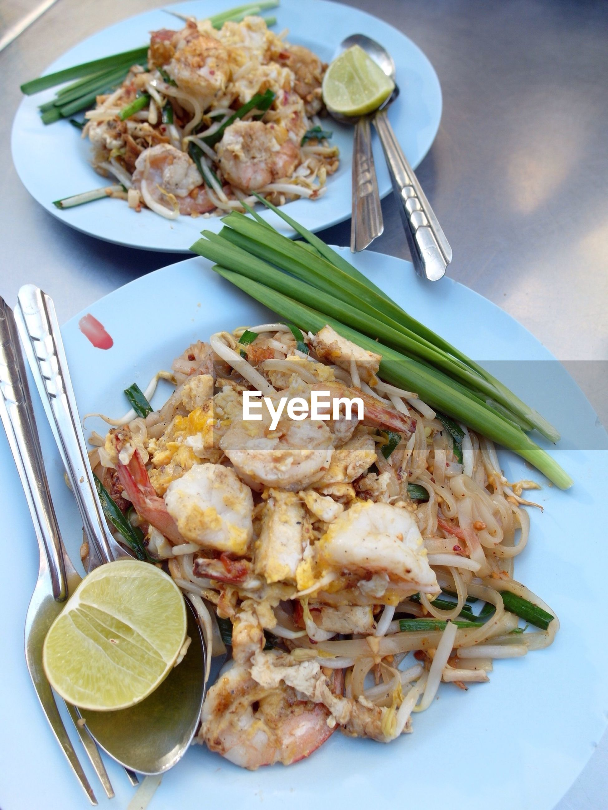 View of pasta with seafood and lime