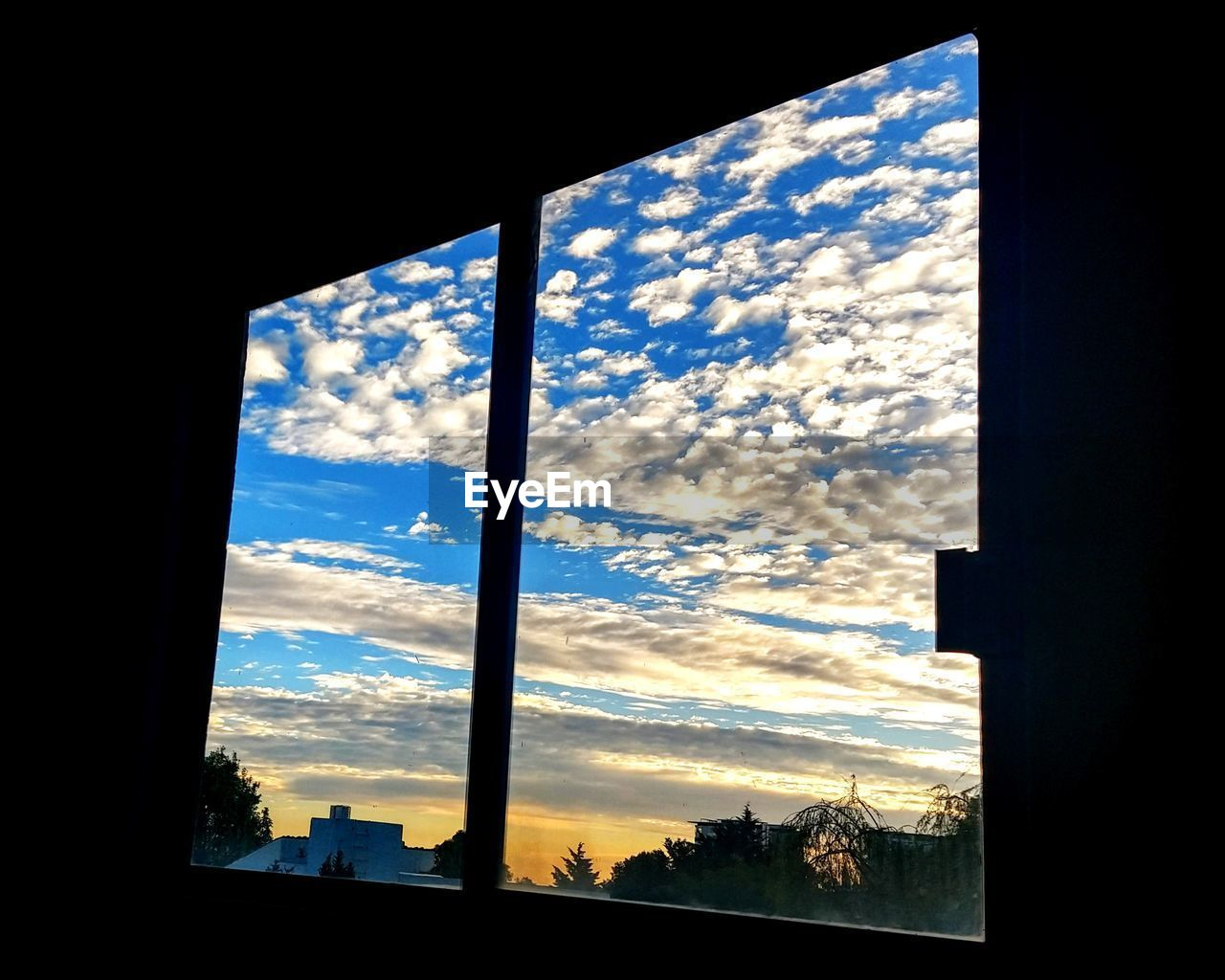 sky, cloud - sky, window, architecture, built structure, nature, silhouette, no people, glass - material, sunset, building exterior, tree, building, transparent, beauty in nature, outdoors, day, low angle view, sunlight