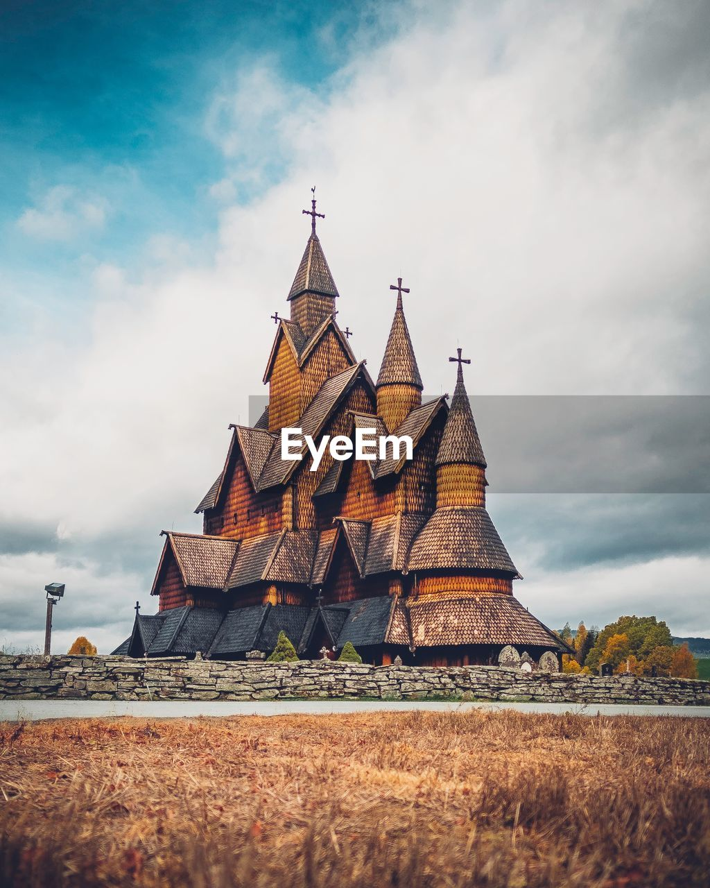cloud - sky, sky, architecture, built structure, religion, place of worship, nature, building exterior, spirituality, belief, no people, building, day, land, low angle view, travel destinations, field, outdoors, spire