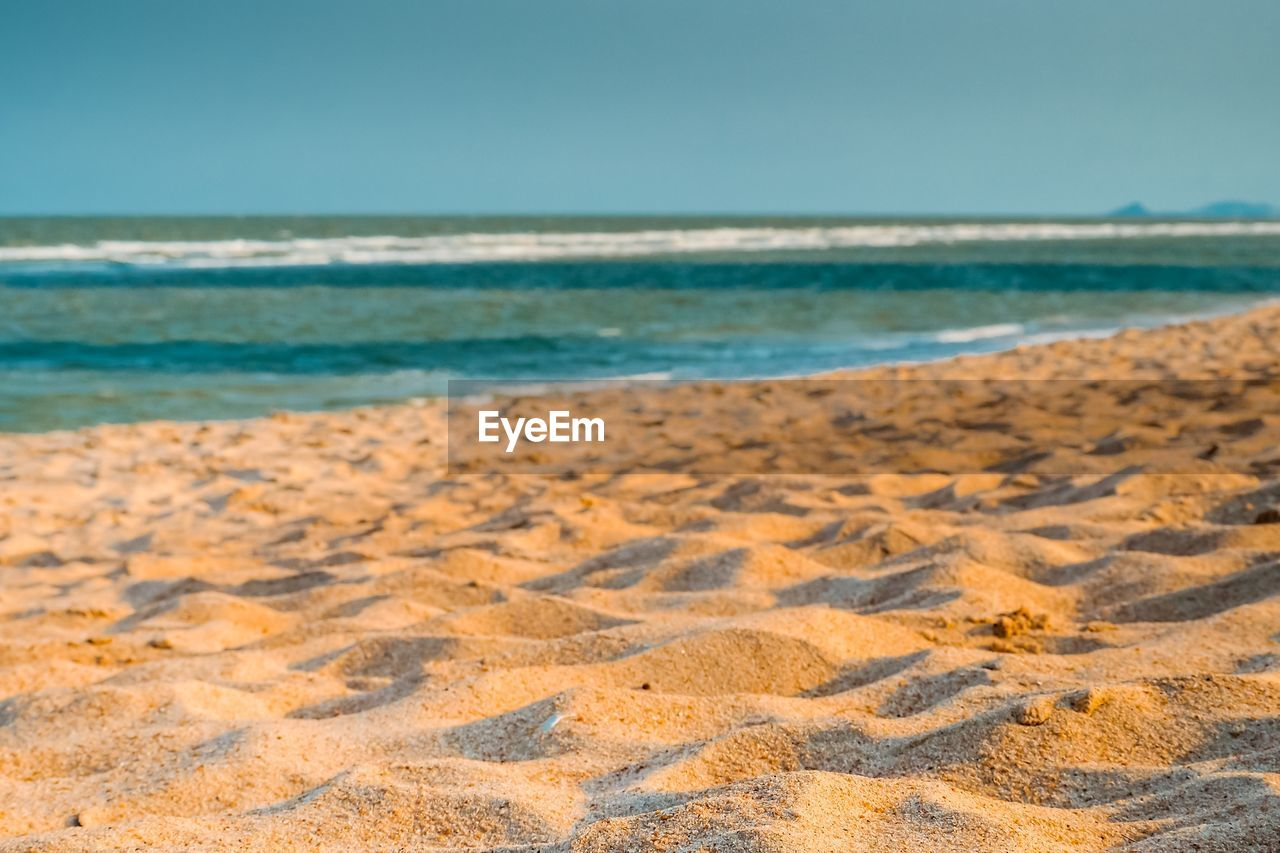 sea, land, beach, sand, water, sky, beauty in nature, scenics - nature, horizon, tranquility, horizon over water, no people, nature, day, tranquil scene, clear sky, wave, idyllic, motion