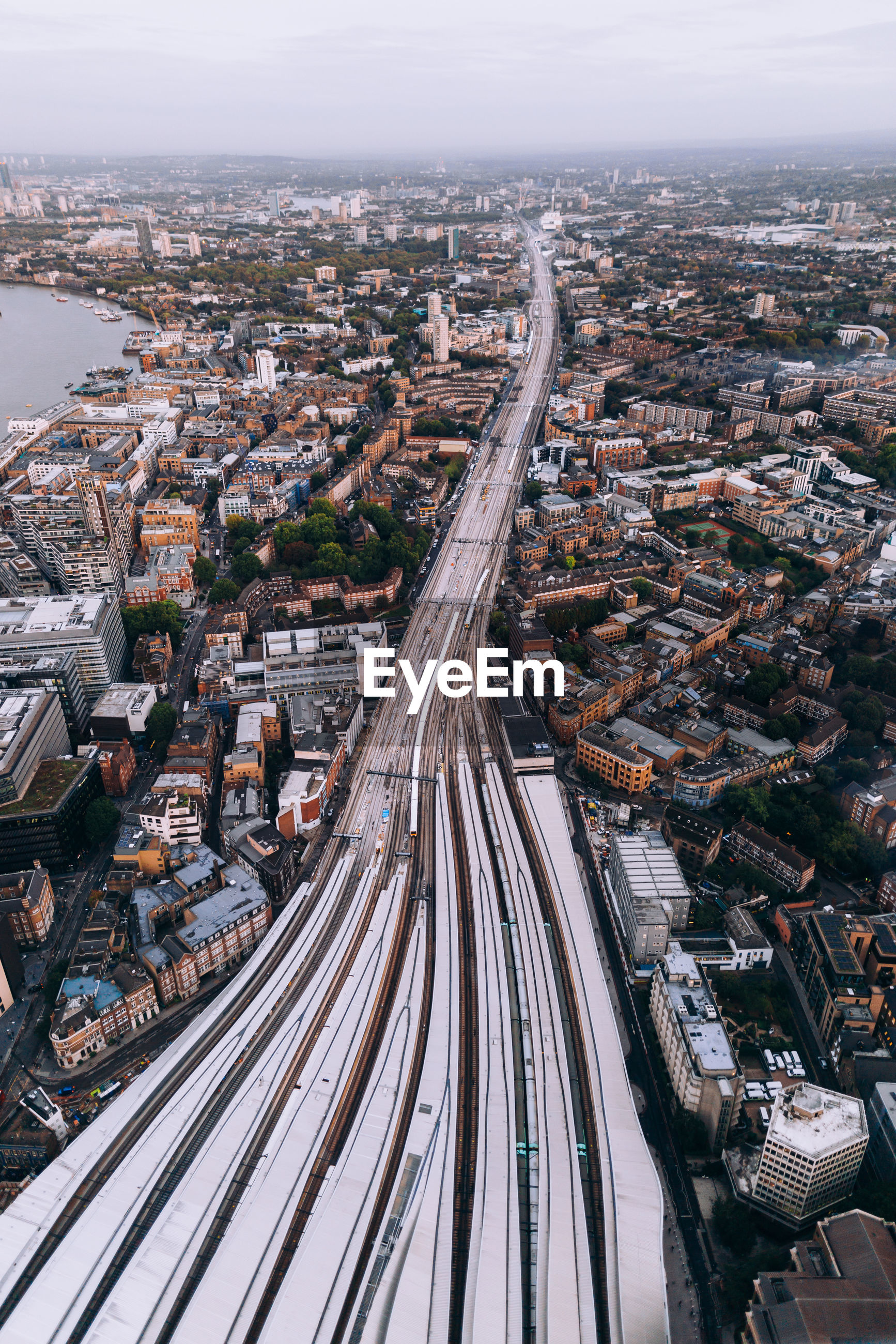 Aerial view of railroad tracks amidst buildings in city