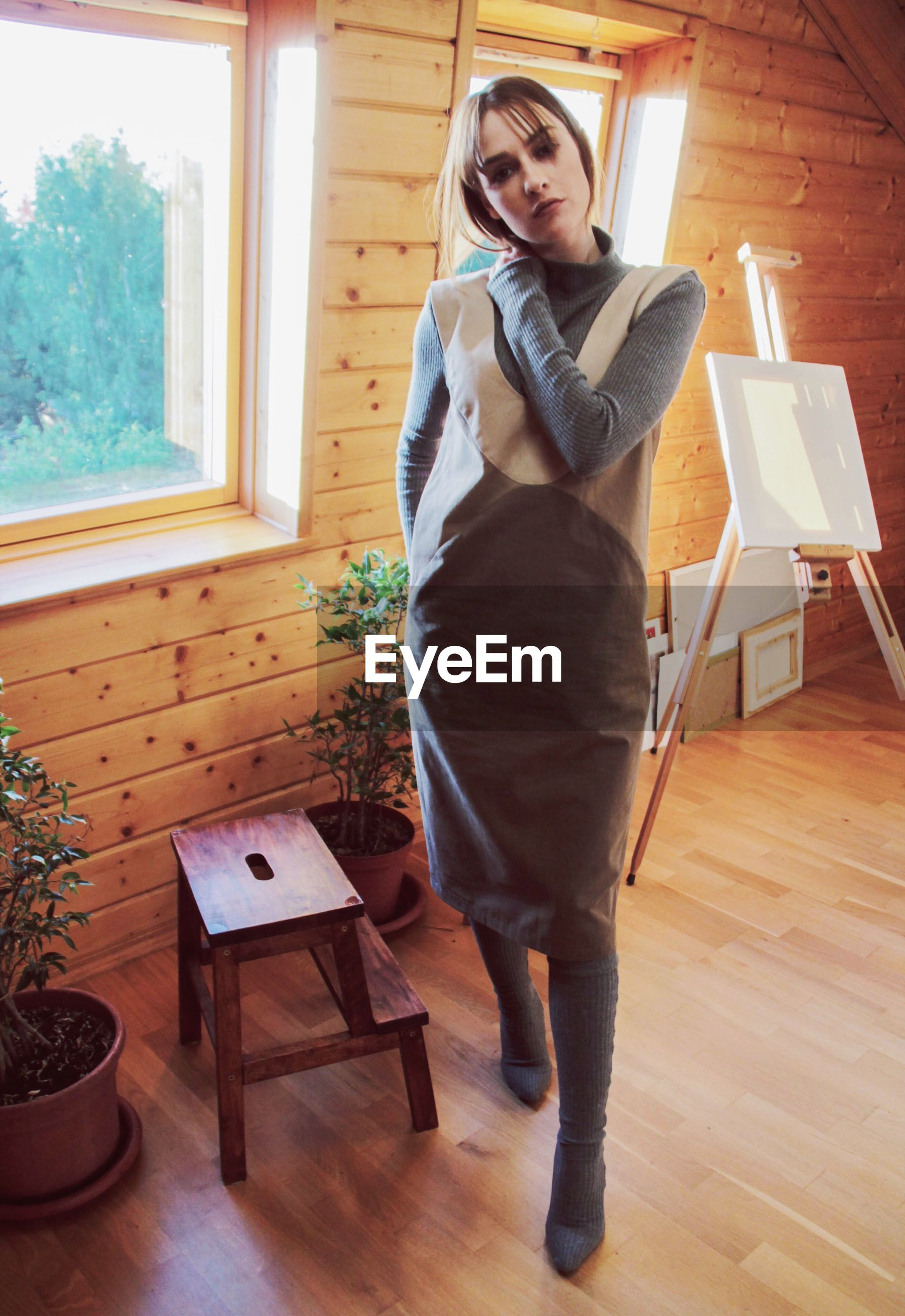 indoors, one person, young adult, full length, young women, front view, hardwood floor, window, real people, standing, table, home interior, looking at camera, day
