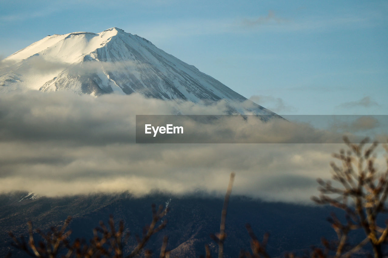 mountain, scenics - nature, sky, cold temperature, snow, beauty in nature, winter, tranquil scene, cloud - sky, snowcapped mountain, tranquility, no people, nature, landscape, mountain peak, non-urban scene, volcano, environment, day, mountain range, outdoors