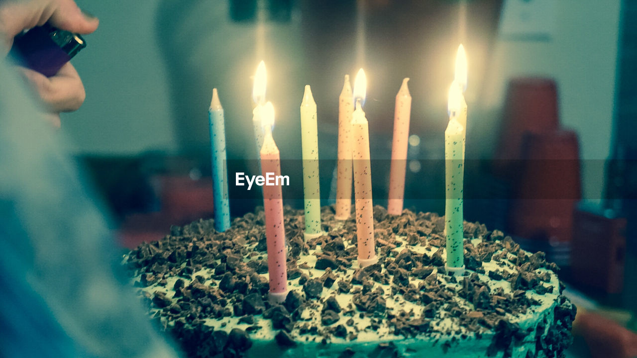 burning, fire, candle, flame, fire - natural phenomenon, cake, holding, one person, birthday, heat - temperature, real people, illuminated, indoors, sweet food, sweet, birthday cake, dessert, selective focus, food and drink, glowing, hand, birthday candles, temptation