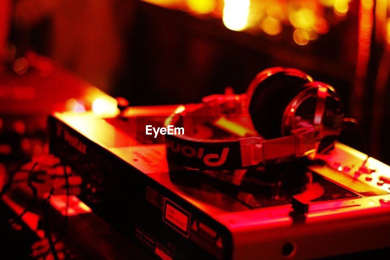 turntable, music, illuminated, no people, night, indoors, close-up, record player needle