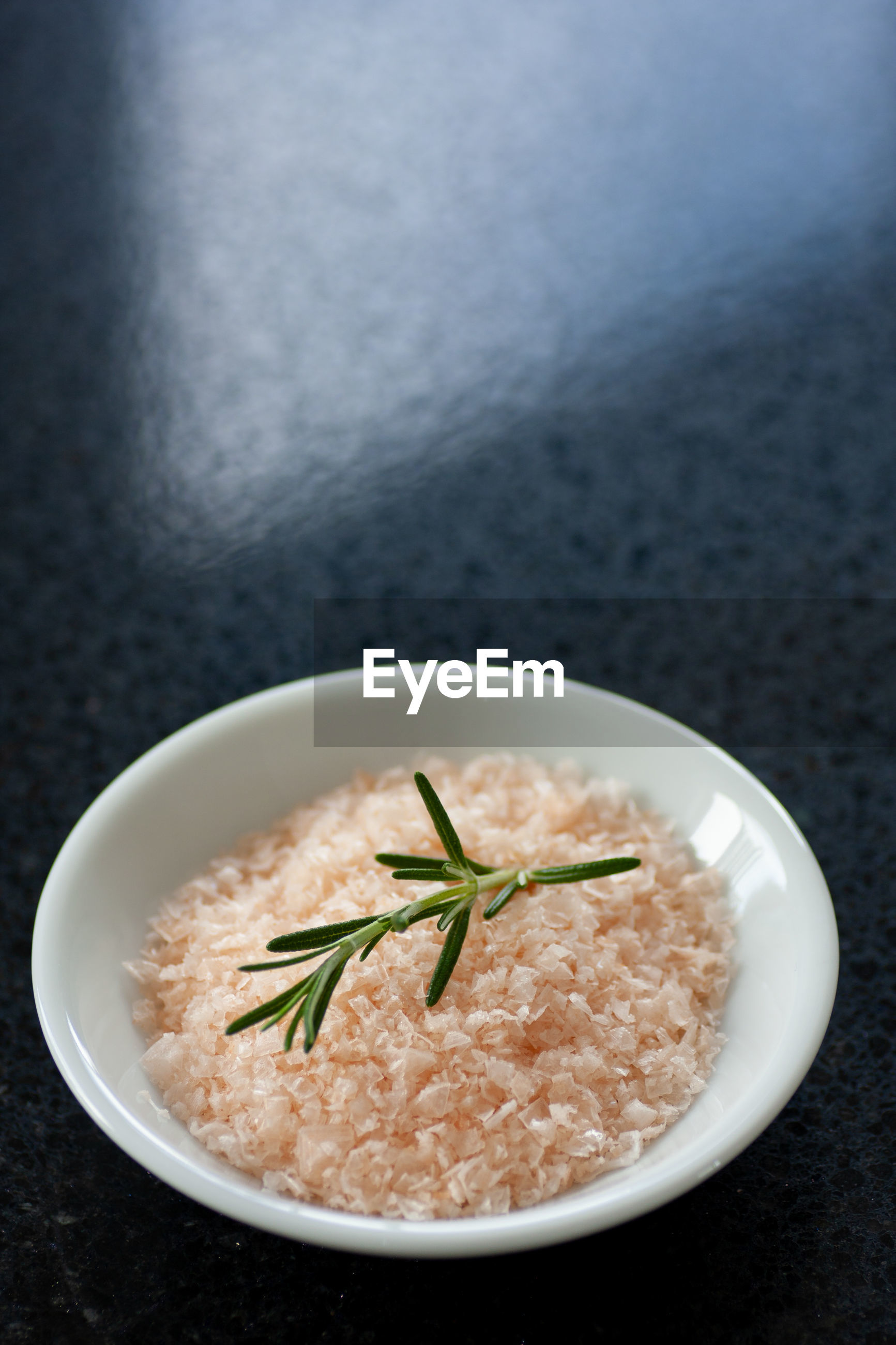 Pink salt with a sprig of rosemary.