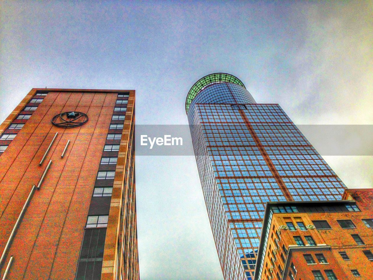 architecture, building exterior, built structure, low angle view, modern, skyscraper, tower, city, day, no people, outdoors, sky, tall