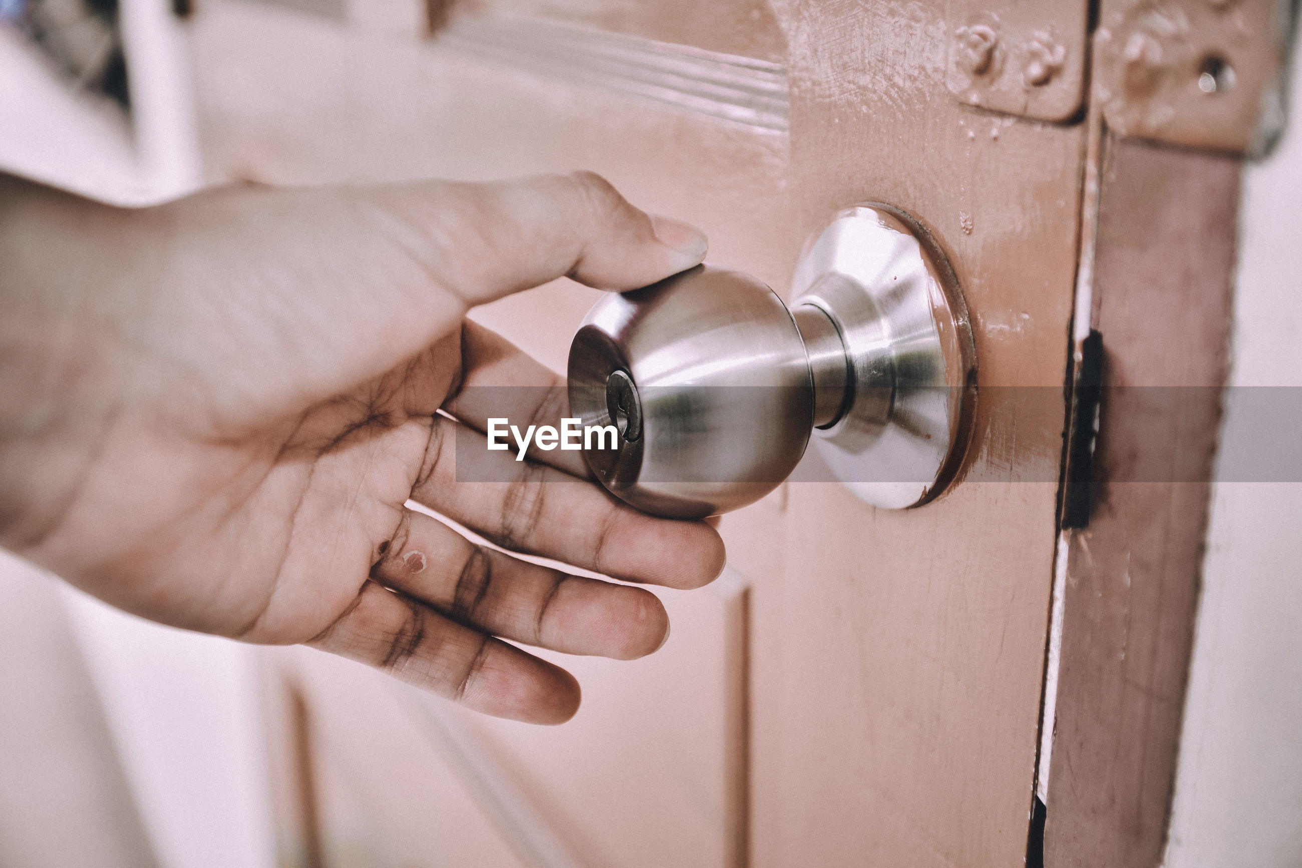 Close-up of hand holding door knob