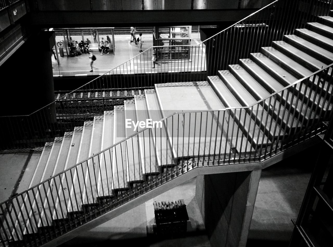 steps and staircases, staircase, steps, railing, real people, high angle view, architecture, indoors, built structure, hand rail, day
