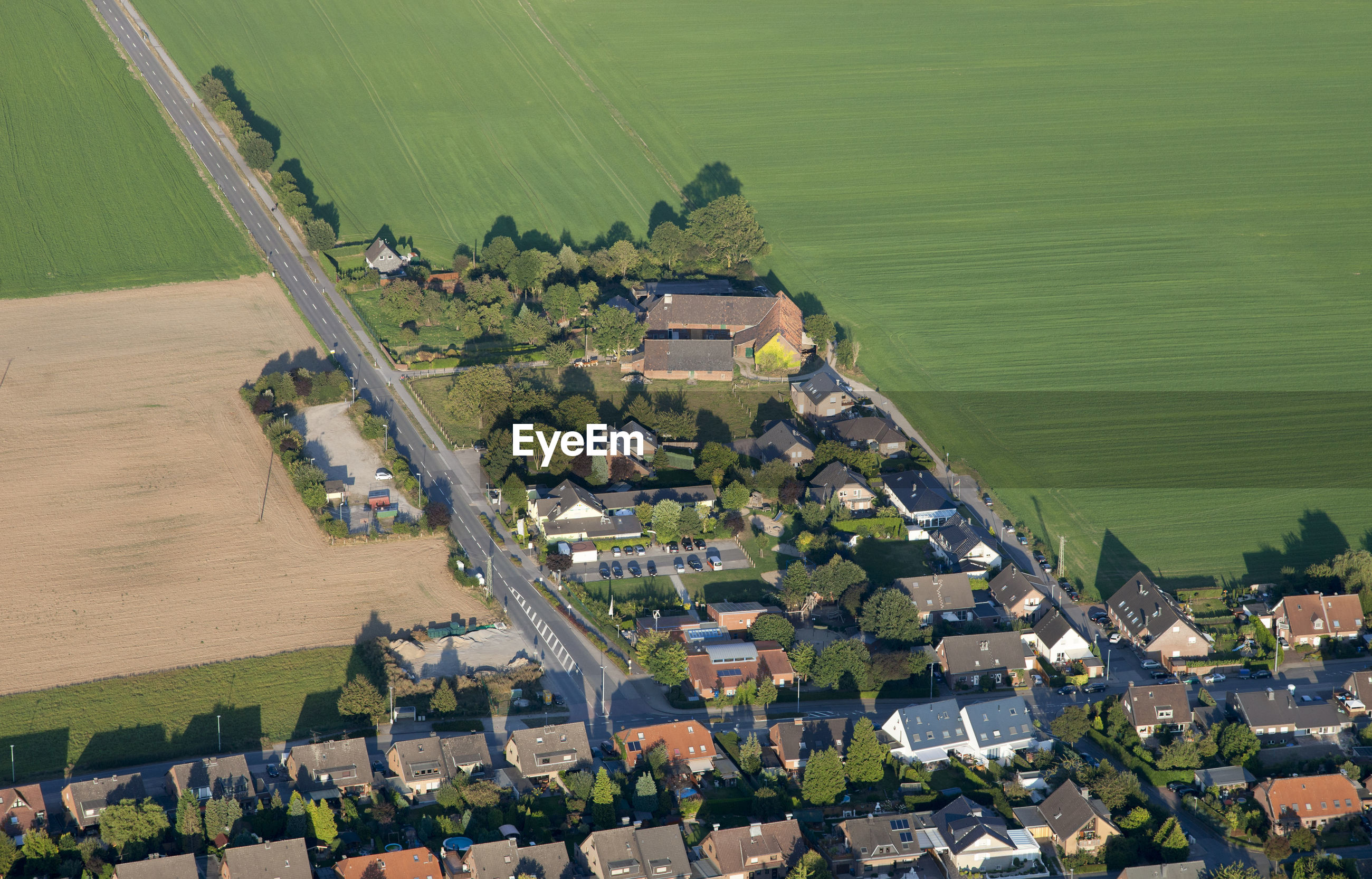 Aerial view of houses by landscape