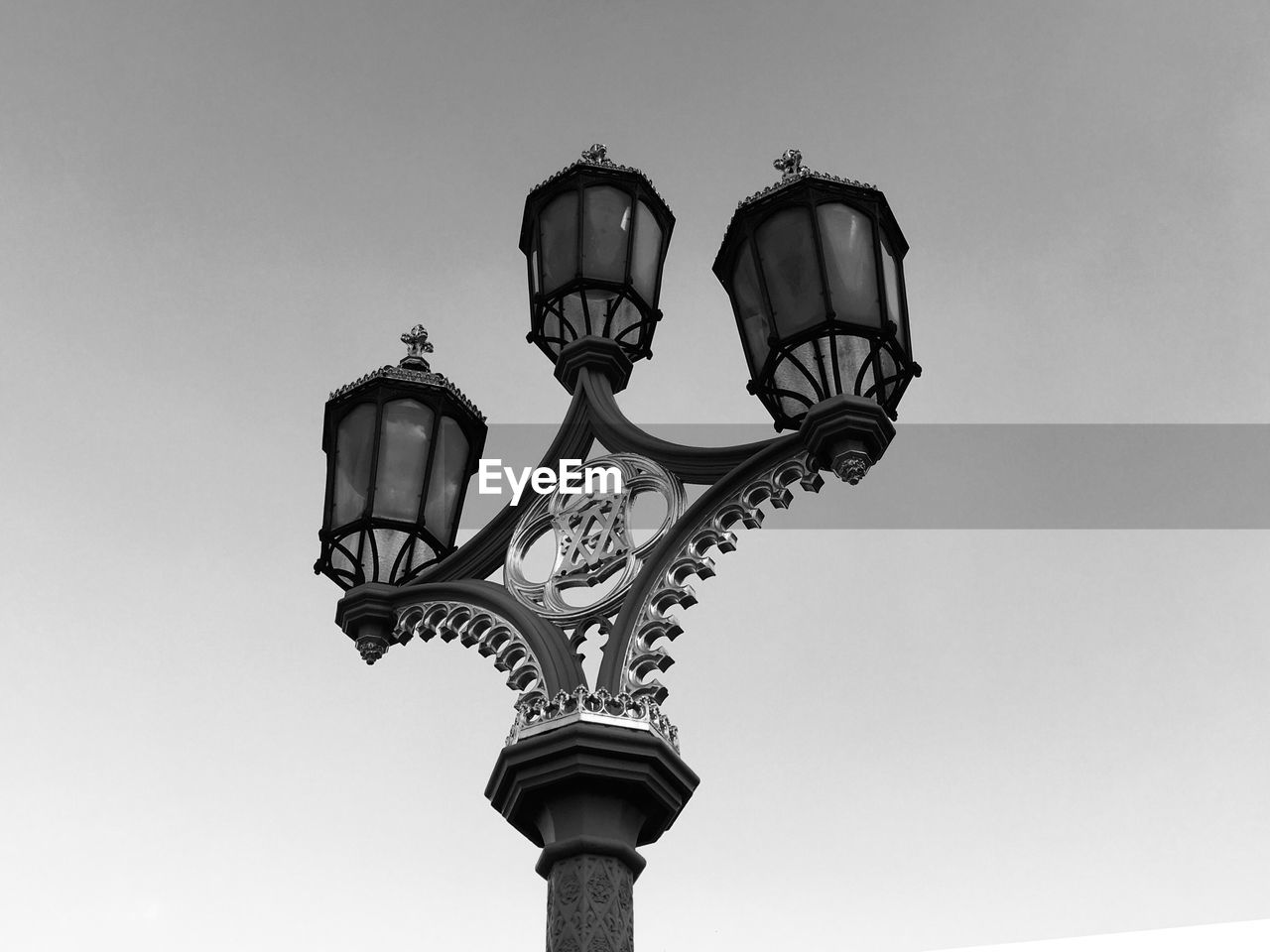 street light, low angle view, sky, street, lighting equipment, clear sky, nature, no people, day, gas light, architecture, outdoors, copy space, design, antique, built structure, electric lamp, electric light, electricity, ornate, wrought iron