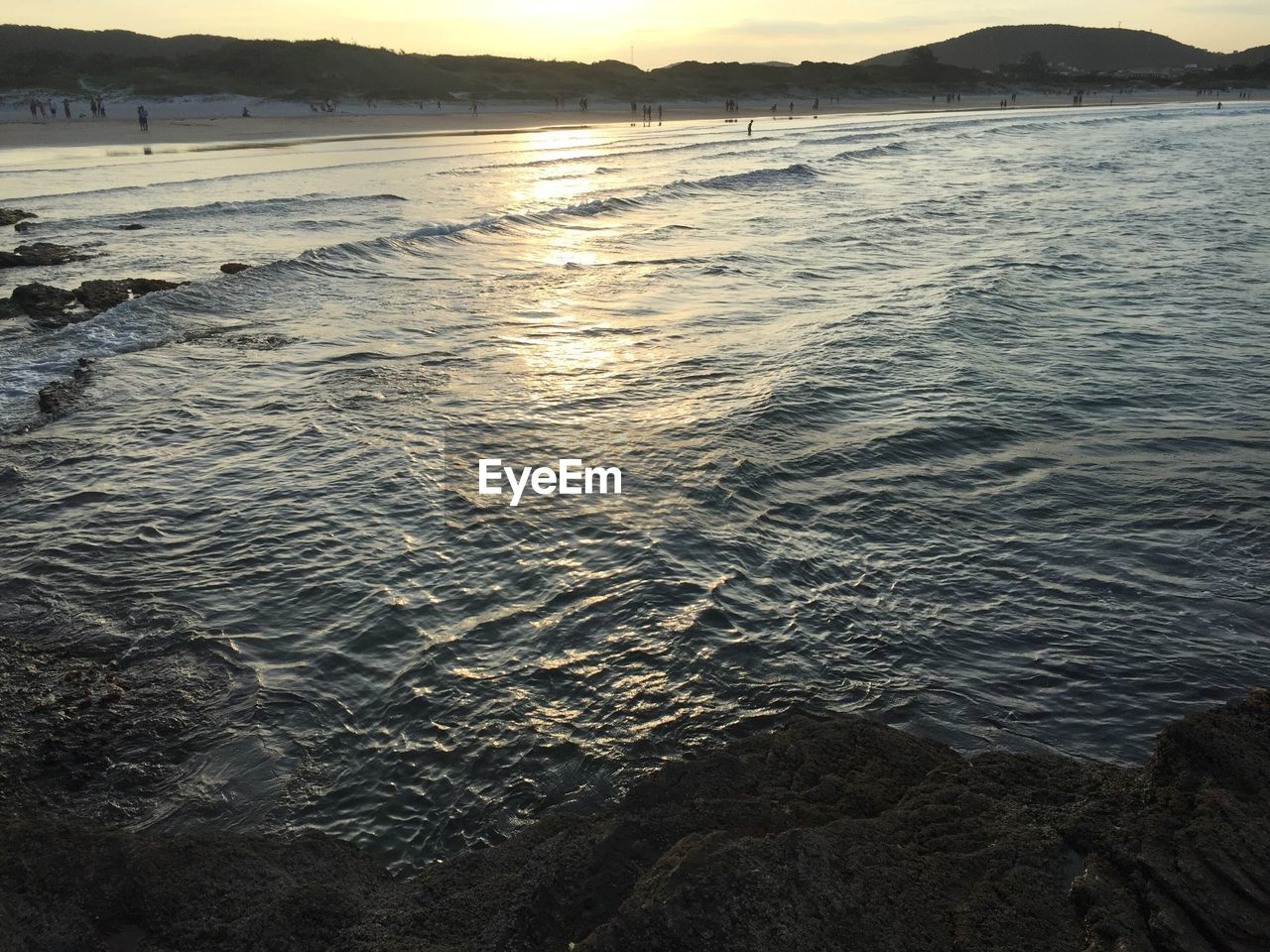water, nature, sea, tranquility, outdoors, scenics, rippled, beauty in nature, tranquil scene, no people, sunset, mountain, day, sky