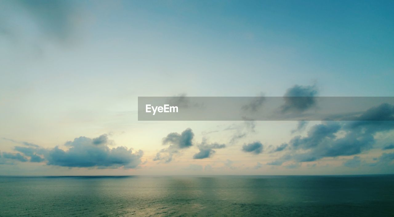 sky, beauty in nature, tranquility, water, scenics - nature, sea, cloud - sky, horizon, horizon over water, tranquil scene, no people, nature, idyllic, waterfront, non-urban scene, outdoors, sunset, seascape, day