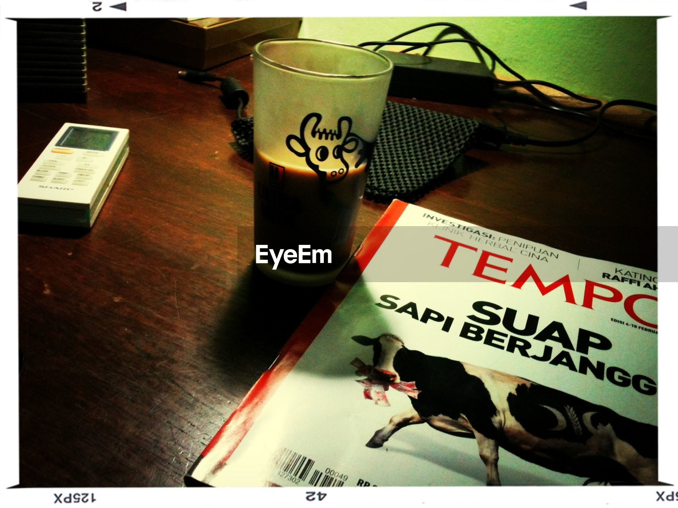 indoors, table, transfer print, text, food and drink, drink, western script, still life, communication, auto post production filter, freshness, refreshment, restaurant, high angle view, close-up, book, drinking glass, no people, paper, education