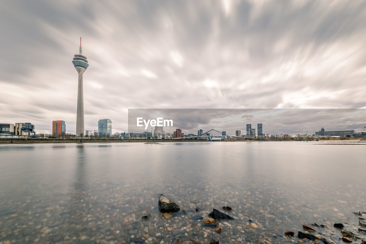 architecture, built structure, sky, tall - high, building exterior, cloud - sky, travel destinations, tower, water, city, tourism, travel, no people, outdoors, skyscraper, day, urban skyline, nature, modern, cityscape