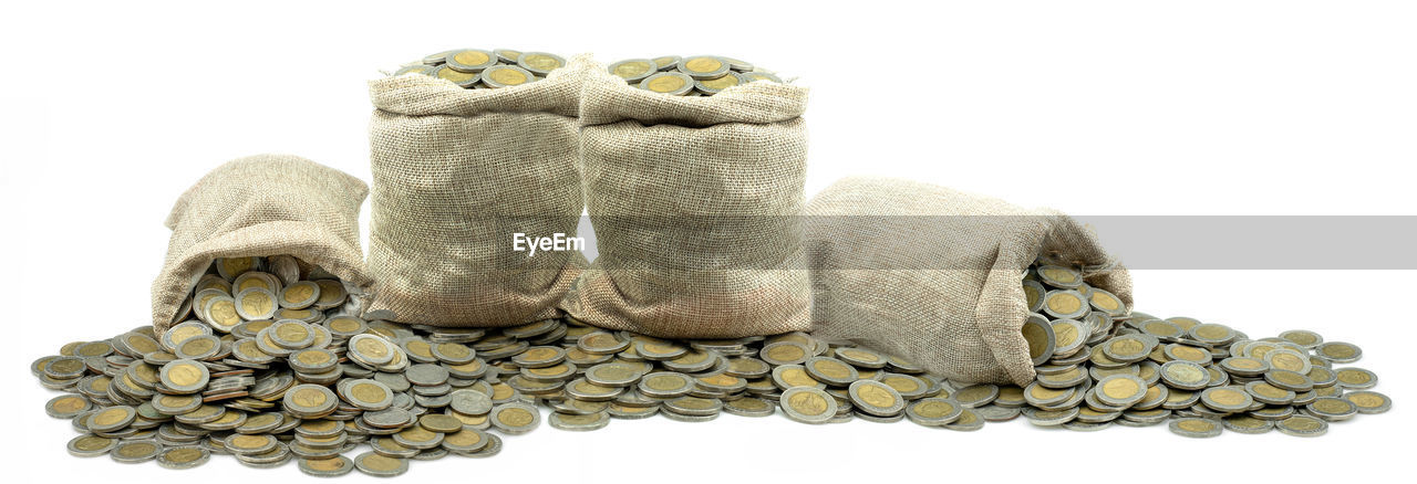 Stacking coin in sack on white background, money stack