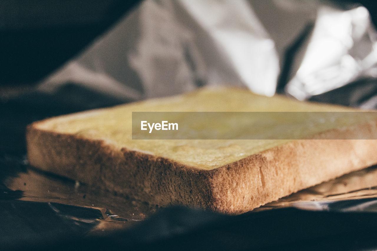 Close-Up Of Bread Slice On Foil
