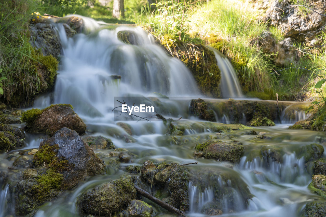 water, flowing water, long exposure, motion, beauty in nature, waterfall, rock, scenics - nature, blurred motion, nature, rock - object, plant, land, flowing, forest, solid, environment, day, tree, no people, outdoors, stream - flowing water, power in nature, falling water, running water