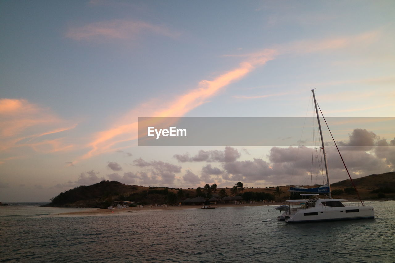 water, sky, nautical vessel, cloud - sky, transportation, mode of transportation, sunset, sea, sailboat, nature, beauty in nature, scenics - nature, waterfront, tranquility, tranquil scene, no people, sailing, outdoors, mast, yacht
